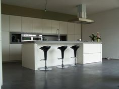 Modern Kitchen Design With Bar Chairs.