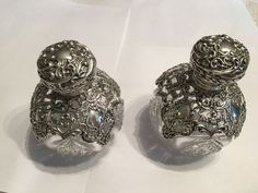 Pair of perfume bottles with silver overlays, William Hutton