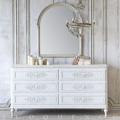"""Eloquence Bronte Dresser in Weathered White finish. Perfectly suited for your European style bedroom! Enjoy the beautiful shape along with an abundance of storage space.    • 37""""H x 72""""W x 23""""D  • Weathered White Finish  • 6 Drawers with Antique Brass Pull Knobs"""