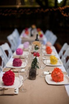 Love the colorful favors at each placesetting; inspiration for favor boxes with a tissue paper pom-pom flower