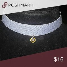 DENIM DBL. CHARM CHOKER WITH SWAROVSKI CRYSTAL Denim choker hand made with double charms. On the front you have a fine Swarovski crystal And in the rear you have a little Buddha watching your back. And as you can see in pic 3 if I say it a swarvoski crystal, It is. colekelley Jewelry Necklaces