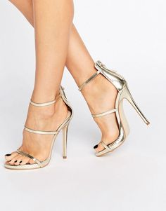 Gold strappy heeled sandals