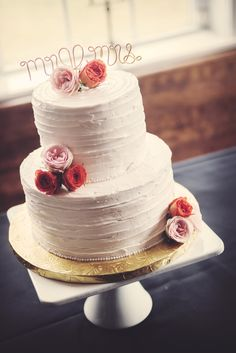 Two-Tier Buttercream Wedding Cake with Pink Flowers and Wire Cake Topper