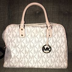 Michael Kors bag Purchased last February. Used it for 3 months then stored it away. Michael Kors Bags