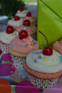 Frost almond cupcakes w/cherry almond frosting and vis versa.  Decorated with polka dot sprinkles & maraschino cherry