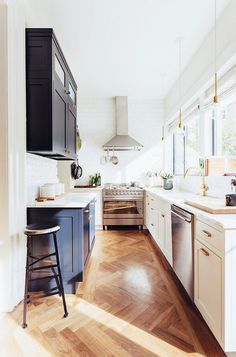 Eclectic chic narrow kitchen with herringbone floor