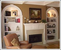 Accessorizing a bookshelf by fireplace
