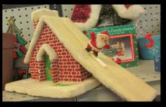 One of my favourite Christmas music boxes.  Pull  Santa to the bottom of the roof and he skis to the chimney.
