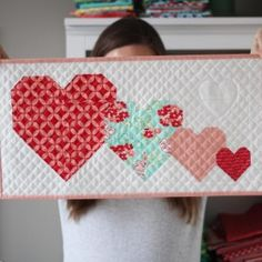 A free mini quilt pattern on the blog today! Linkhellip-Making Heart Blocks in Multiple Sizes.. To make each heart block (just the center heart portion) you need 2 print strips, 2 large background squares, and 4 small background squares.  Here's a table with the sizes and pieces to cut: