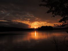 Sunrise over Holy Bay Lake Minocqua by Ken Groezinger
