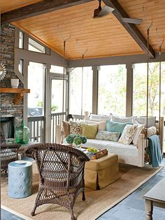 This screen porch provides the best of indoors and outdoors. Screens let the breeze in and keep the bugs out, while comfortable furnishings, a fireplace, and ceiling fan provide indoor-quality amenities. Opting for a swing instead of a sofa recalls the feel of a front porch.