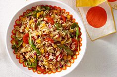 Cherry tomatoes and orzo are the stars of this cold pasta salad made with a mix of fresh veggies and canned artichoke hearts.