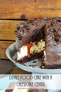 This Devil's Food Cake with a Cheesecake Center from Lady Behind the Curtain is two desserts in one! Two layers of dark chocolate Devil's food cake, a wonderful cheesecake in the middle with a delicio Best Dessert Recipes, Fun Desserts, Delicious Desserts, Cookbook Recipes, Sweets Recipes, Dessert Ideas, Cake Ideas, Cookie Recipes, Best Cheesecake