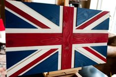 """Flag sizes available: 18x12"""" 36x20"""" 50x27"""" Custom sizes available upon request. Also known as the Union Flag, the Union Jack is the national flag of the United Kingdom and one of the most recognizable flags of the world. The flag combines three older national flag designs: England's red cross of St. George, Scotland's white saltire of St. Andrew, and Ireland's red saltire of St. Patrick. The current flag's design was adopted on January 1, 1801 with the passing of the Act of Uni..."""
