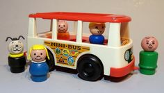 This little bus was a pull toy. When you pulled it, the little people popped up and down like they were riding a real bus.