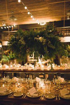 hanging centerpiece with winter greens, photo by Lauren Fair Photography http://ruffledblog.com/terrain-winter-wedding #centerpieces #reception #winter