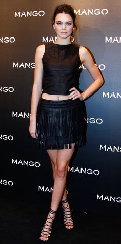 As the new face of Mango, Kendall Jenner was the guest of honor at the brand's Tribal Spirit party, and she wore a black shell top and a fringed skirt, both by Mango (that together, rings in under $100), with black lace-up sandals for the occasion.