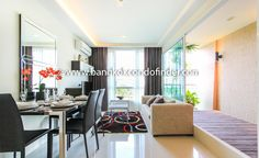 2-Bedroom Apartment For Rent Beverly 33 To find out more of this building & available apartments or condos for rent, go to:   http://bangkokcondofinder.com/bangkok-condos-for-rent/ In this unique and serviced 2-bedroom apartment for rent Beverly 33, the floor to ceiling sliding glass door behind the sofa not only opens to a balcony but also includes the great outdoors as part of the apartment's decor.  With 67 square meters, this 2-bedroom and 2-bathroom apartment
