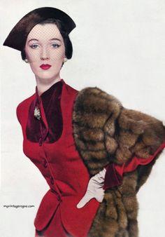 Dovima ravishing is lush ruby red, 1950
