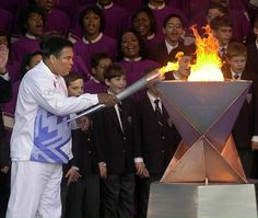 Ali lighting the Olympic torch at Centennial Olympic Park in Atlanta, December 2001, to kick off the Olympic Torch Relay to Salt Lake City for the 2002 Winter Games. (Curtis Compton/AFP)