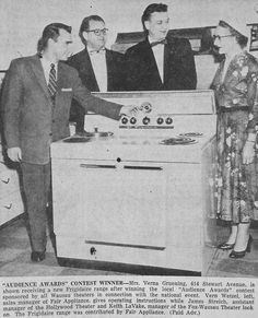 """Dec. 19, 1955 - Mrs. Verna Gruening of 414 Stewart Ave. in Wausau receives a Frigidaire range after winning the local """"Audience Awards"""" contest sponsored by all Wausau, Wisconsin theaters."""