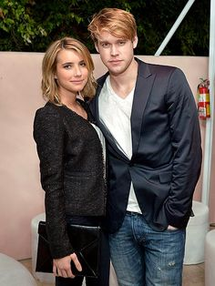 'HOT' STUFF  Emma Roberts and beau Chord Overstreet stay close during Condé Nast Traveler's Hot List party Thursday in L.A.
