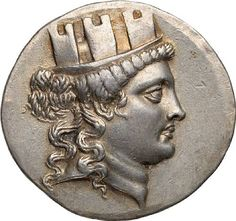 Ionia, Smyrna, Tetradrachm, 150-145 BC  16.7g. Obverse: Turreted head of Tyche or Kybele right / ZMYP-ΝΑΙΩΝ in two lines, monogram of magistrate below; all within oak wreath. Well defined and well centered, a highly collectible.