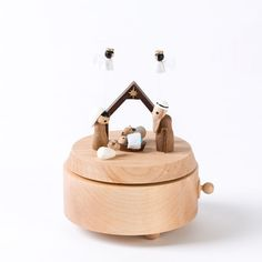 """The classic nativity scene rotates as """"Away In a Manger"""" plays in this collectible music box. Each musical gift is handcrafted from eco-friendly, sustainable wood, and fitted with Sankyo musical movement."""