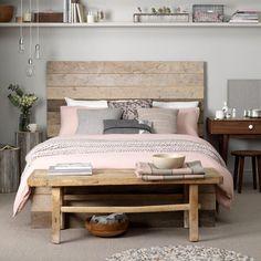 Coastal-inspired bedroom love the shelf across the headboard wall!