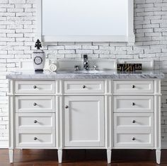 "The Brittany 60"" Cottage White single vanity by James Martin features classic details with bridge both Traditional and Transitional styles. This beautiful piece"