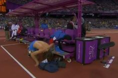 Ivan Ukhov loosing his vest on the way to winning the high jump!