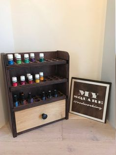 Essential oil storage shelf (holds 72 bottles) with drawer by MySquareWoodworking on Etsy