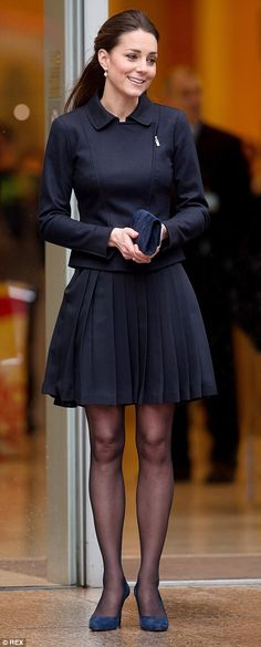 The Duchess of Cambridge in a belted black ensemble for a charity visit last November