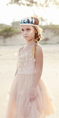 The fabulous Firefly Headband features plumes of turquoise, black and white feathers and is embellished with a barrette of gold bugle and round beads.  www.tutudumonde.com