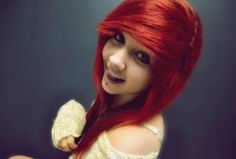 I think it looks so cool when people can pull off bright red hair. But you really have to pull it off. It can be so striking and beautiful, though. It really can. :)