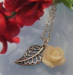 A single flower grows A rose necklace by cleverlyjillbilly on Etsy, $16.00