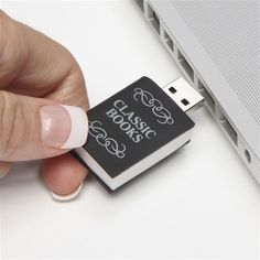 USB drive with classic books. A wonderful gift idea for a book nerd who still hesitates whether ebooks are worth the try. This USB drive looks like a tiny book and holds public domain English-language classic books! I Love Books, Good Books, My Books, Reading Books, Usb Drive, Usb Flash Drive, Must Have Gadgets, Usb Stick, Classic Books