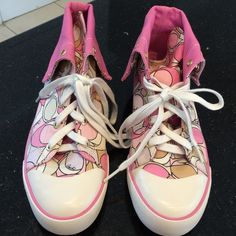 NWOT Coach Hi Top Sneakers. Pink coach design. Can be worn up or down. Brand new condition except for slight marks on white tips. Hardly noticeable. Coach Shoes Sneakers
