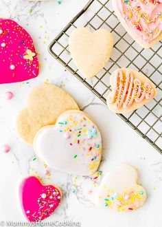 These Eggless Sugar Cookies are tender, buttery, keep their shape when baked, and yes, taste amazing, too. Plus, they're easy to make with simple ingredients. Serve them with or without icing and watch them disappear right before your eyes! @mommyhomecookin #recipe #eggfree #eggless #egglessbaking #eggallergy #sugar #cookies #christmas #holidays