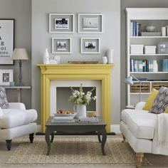 Grey living room with feature fire place. Using a bright colour like yellow really helps to make it stand out. Love this idea. It's almost like a black & white picture with a spot colour