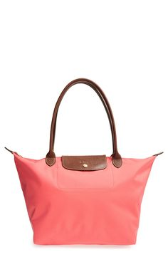 Coral Longchamp tote is the perfect travel bag.