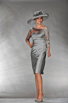 Mother Of The Bride / Groom Outfit: Silver knee length dress with tulle covering one shoulder and embroidered lace on one arm