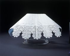 """Collar: 1630-1640, Honiton, England, linen edged with bobbin lace with tassels of knotted linen thread. """"Lace like this appears in a number of English portraits of the 1630s and early 1640s, and custom for it was at the highest social level. The Countess of Leicester, wife to the English Ambassador to France, was commissioned to purchase English bobbin lace as a present for Anne of Austria, the French Queen, in 1637 and complained of the considerable expense."""""""