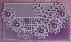 My own design and creation, an unusual white work lace pattern on a purple parchment sheet, with grid work and cut-outs. From my collection: Dainty Designs No. 7.