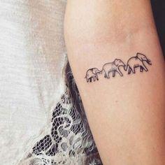 Tatouage femme Éléphant Noir et gris sur Bras