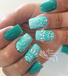 Turquoise green is for the ladies that is gentle spirit, combined with white patterns looks very interesting. White small pearls give these nails seductive line.
