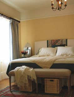 Going Green: Using Natural Materials in Your Home. Upholstered headboard with southwest fabric bedroom
