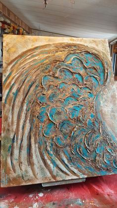 my guilded angel wing. prep ,light molding paste, crackel medium. has a white n light blue under coat. topped with gold and copper paint to add shimmer. 24x30
