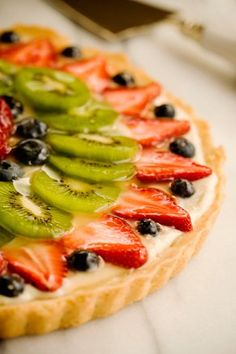 """FRESH FRUIT TART - it's by Paula Deen,so the """"fresh fruit"""" part is meant to lull you into believing this is healthy. Was very tasty. Köstliche Desserts, Delicious Desserts, Dessert Recipes, Yummy Food, Tasty, Health Desserts, Paula Deen, Kiwi Recipes, Fruit Tart Recipes"""