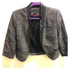 Black and white tweed blazer with leather Black and white tweed blazer. Great for dressing up for work or over a black top for going out. Has faux leather detailing. Small fabric imperfection on the inside of the left sleeve (as seen in photo). 3 quarter length sleeves. Willi Smith Jackets & Coats Blazers
